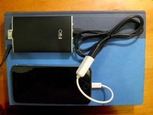 Fiio Q1, Micro USB cable, USB Lightning camer adapter, and iPhone